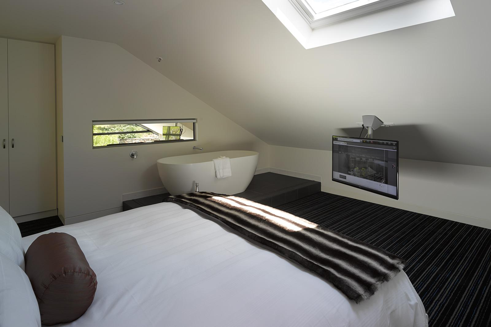 King sized bed on Loft Penthouse at Salamanca Wharf Hotel