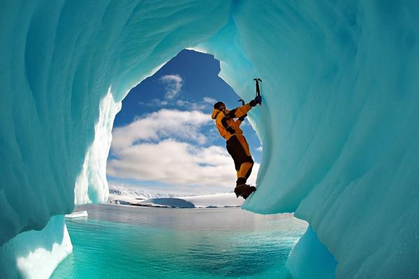 Climbing an ice cave in Antarctica
